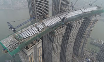 Moshe Safdie's Chongqing megadevelopment—featuring the world's highest, tower-spanning sky bridge—reaches structural completion