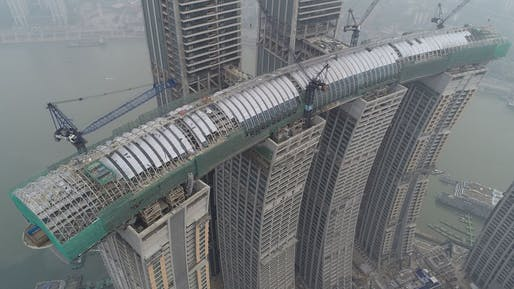 Aerial view of 'The Crystal' sky bridge, centerpiece of the now structurally completed Raffles City Chongqing megastructure. Image: CapitaLand.