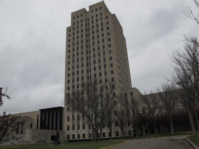 """(Dale Wetzel/ Associated Press ) - This photo, taken Thursday, April 19, 2012, shows the North Dakota Capitol, whose main tower is almost 250 feet high. The Republican majority leader of the Minnesota House on Thursday described the North Dakota Capitol building, which is located in Bismarck, N.D., as """"embarrassing"""" and compared it to an insurance office. His remarks came during debate in the Minnesota Legislature in St. Paul, Minn., about whether to set aside money for repairs to the..."""