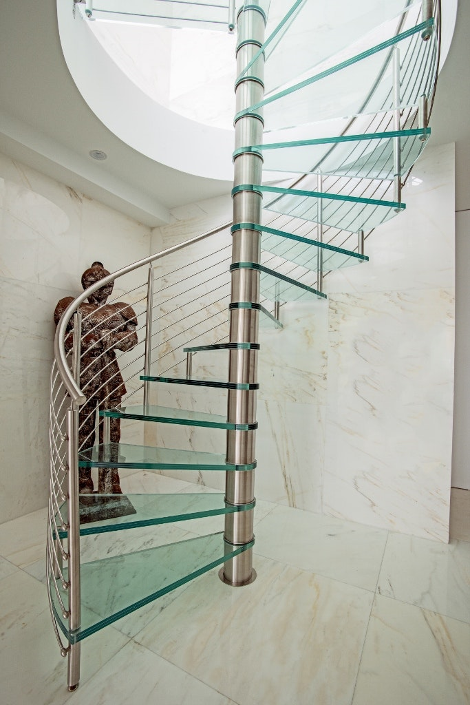 Spiral Staircase Featuring Stainless Steel Railings With Glass Treads U0026  Landing.