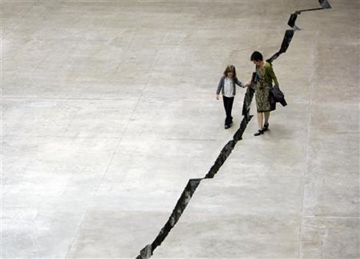 Doris Salcedo's 'Shibboleth' was specially made for the Turbine Hall of the Tate Modern and consisted of a large crack carved into the floor of the room. Credit: Luke MacGregor / Reuters