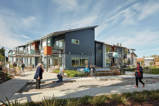 Residents enjoy the bocce ball court at the end of the pathway. Smaller community building and resident apartments of Half Moon Village Phase 2 face of the bocce ball court. Photo by Bruce Damonte.