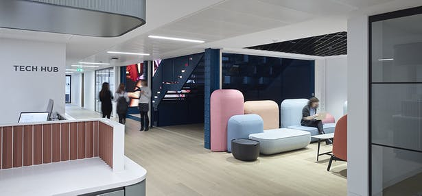 Modular seating in pastels adds playfulness in breakout areas