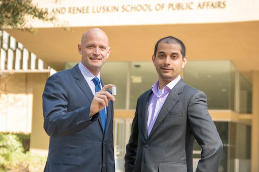 UCLA researchers J.R. DeShazo, left, and Gaurav Sant, with the CO2 infused building material. Photo by Roberto Gudino, via luskin.ucla.edu.