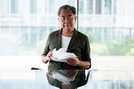 Kengo Kuma holding METARIDE AMU running shoe. Image © ASICS