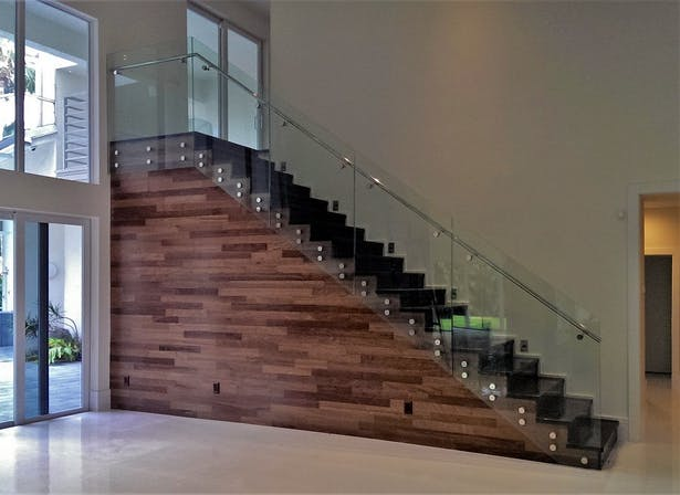 Glass panel railings feature polished stainless steel elements
