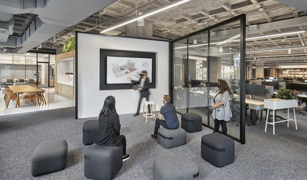Spaces can pivot in function effortlessly for team collaboration, individual work, or VR demonstrations. Photo Credit: Garrett Rowland