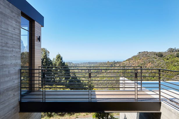 The home's bridges offer new perspectives for experiencing the owner's prized views while providing a glimpse of the topography as it stood before the house was set upon it. (Roger Davies Photography)