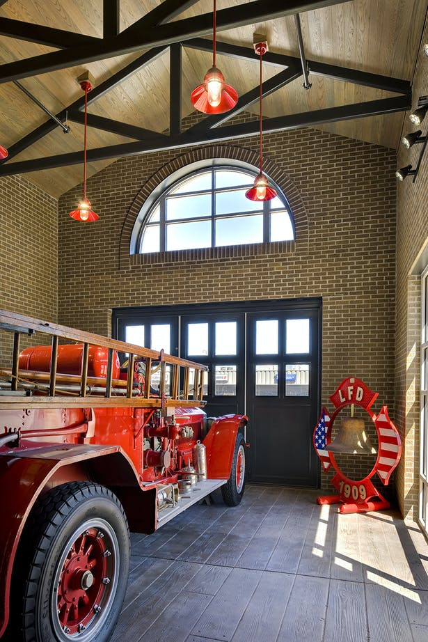 Lubbock FS 1 Lobby with vintage fire engine display. (WHJ)