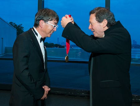 Toyo Ito, 2013 Laureate, is awarded the Pritzker's bronze medal by Thomas J. Pritzker. © Rick Friedman