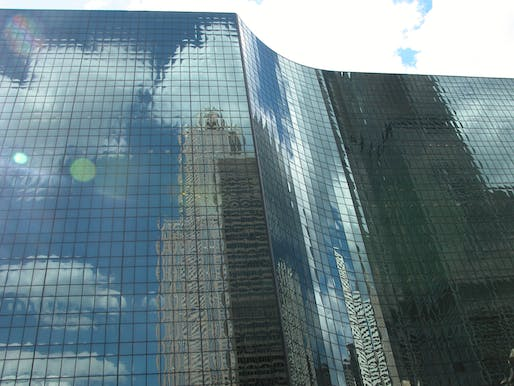 ". Photo courtesy of Wikimedia user<a href=""https://commons.wikimedia.org/wiki/File:Glass_building_in_Chicago.jpg"">Procsilas Moscas</a>"