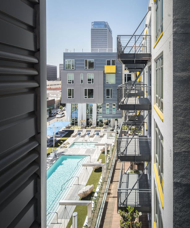 Third-floor amenities are positioned to maximize both sunlight to the pool area and city views from the deck.