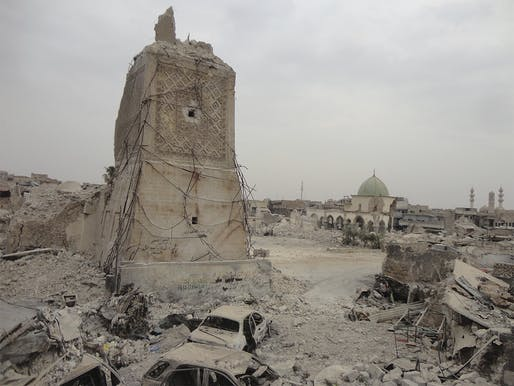 Remains of the Al-Hadba' Minaret of the Great Mosque of al-Nuri in Mosul, Iraq. Built in 1172, the historic structure was destroyed by Islamic State militants on June 2, 2017. Image via World Monuments Fund/Google.