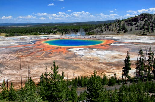 Shown: The Grand Prismatic Spring and Midway Geyser Basin at Yellowstone National Park. Image courtesy Wikimedia user Brocken Inaglory.