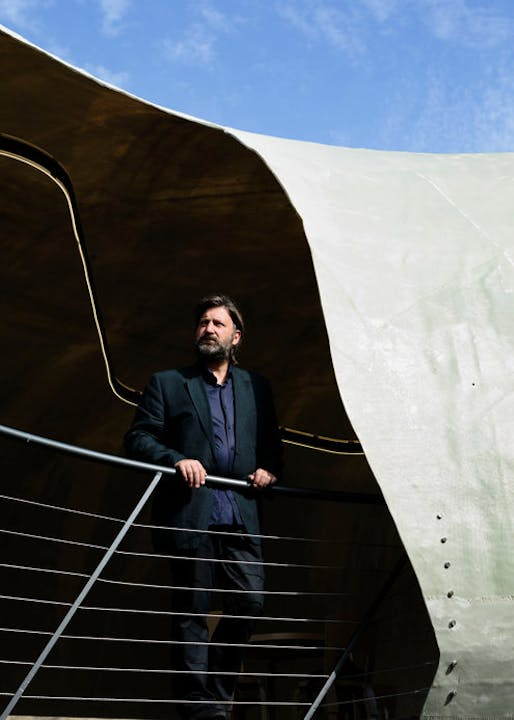 The Chilean architect Smiljan Radic, left, inside the pavilion he designed in Kensington Gardens in London for the Serpentine Galleries. Credit: David Azia for The New York Times
