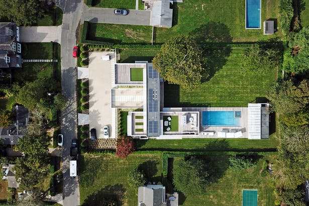 An Aerial Drone Shot Shows the Numerous Outdoor Living Spaces