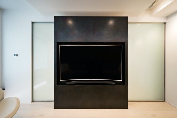A Black Steel Volume Holds a TV Niche