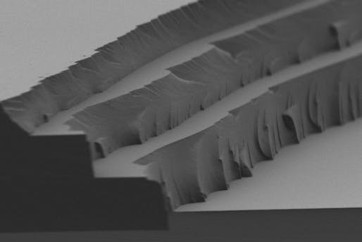 Microscopic view of the new MIT-developed solar thermal fuel polymer film and its three distinct layers—each 4 to 5 microns thick. (Image: MIT)