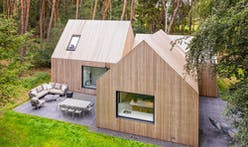 This wooden villa offers views of a tranquil Netherlands landscape