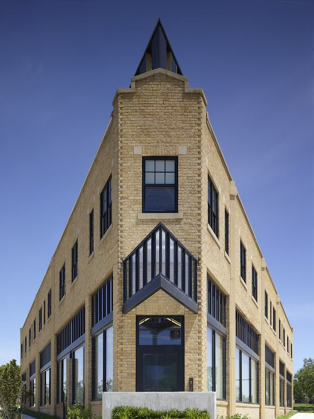 The classic flatiron view including the new 3rd floor addition and enhanced main entry door canopy.