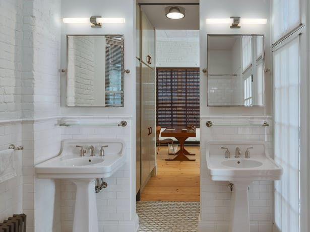 The loft features 1.5 bathrooms. Classic fixtures complement the historic material palate.