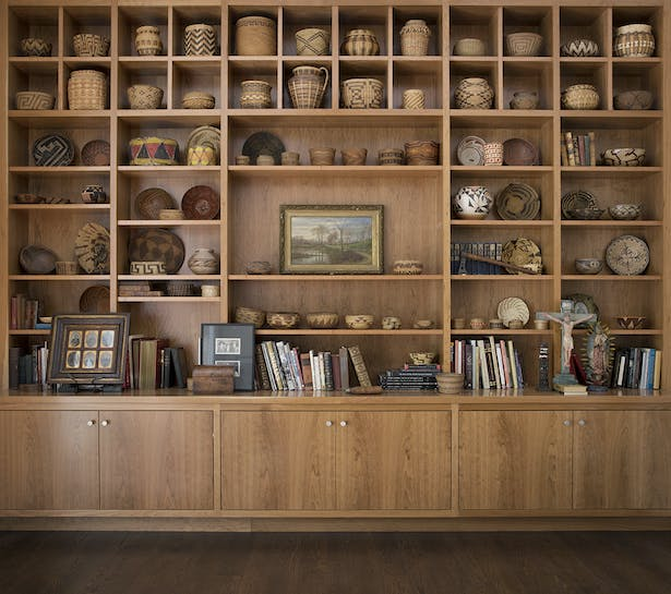 Creating ample gallery space for the owner's Native American artifacts, baskets, craftsman furniture, landscape paintings and other decorative objects was one of the central design moves.