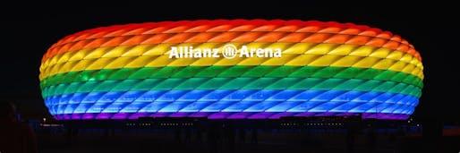Allianz Arena illuminated for Christopher Street Day in Munich. Image courtesy Wikimedia Commons user Sinnbildner.