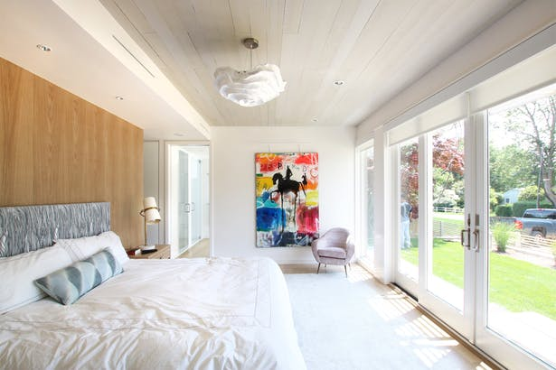 The Master Bedroom Opens to the Exterior with Sliding Glass Doors