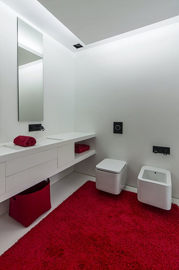 main bedroom (Cabinet, wash basin and bathtub made in Corian®)