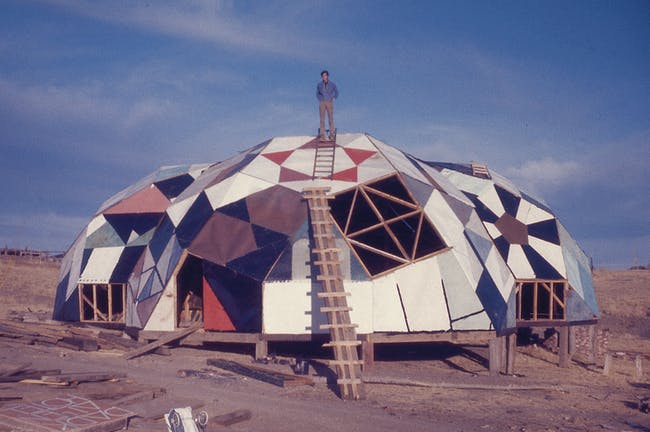 Film still from Joan Grossman's 2012 documentary 'Drop City' where three students from University of Kansas in Lawrence built recycled, low-cost geodesic domes. Buckminster Fuller awarded the designers his Dymaxion Award in 1966. Image from affr.nl.