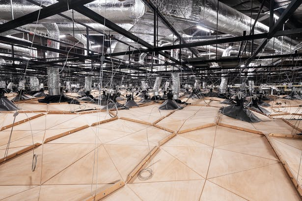 WOOD-SKIN ceiling is supported by a series of guylines that serve both a structural and aesthetic function, whose positioning and measure is also defined by software. Photo Credits: DSL Studio