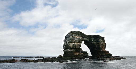 The US Military has been allowed to use the Galapagos Islands as a military base by the government of Ecuador. Pictured: Darwin's Arch off of the islands. Image courtesy of Flickr user Refractor.