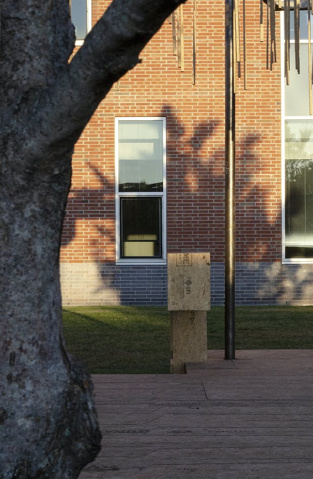 The project used the single window on the school facade to locate several spatial axis within the project. This same window cuts a diagonal along one edge to frame the First Christian Church Tower.