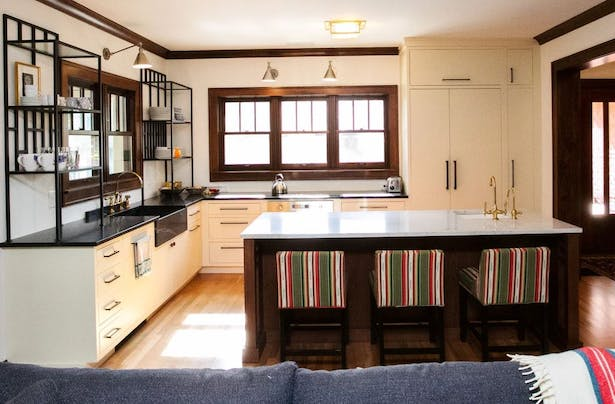 Kitchen with island and new windows overlooking side yard.