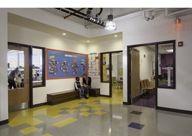 Classrooms are clustered by grade and designated by color. Shared break-out nooks for each grade cluster provide a 'front' porch along the corridor.