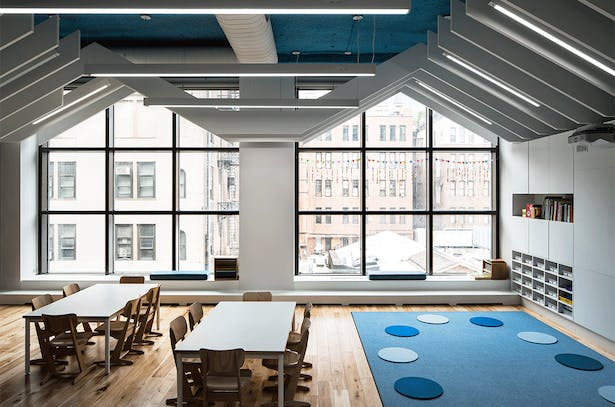 Classrooms were designed to harvest and accentuate natural light from the full-height windows.