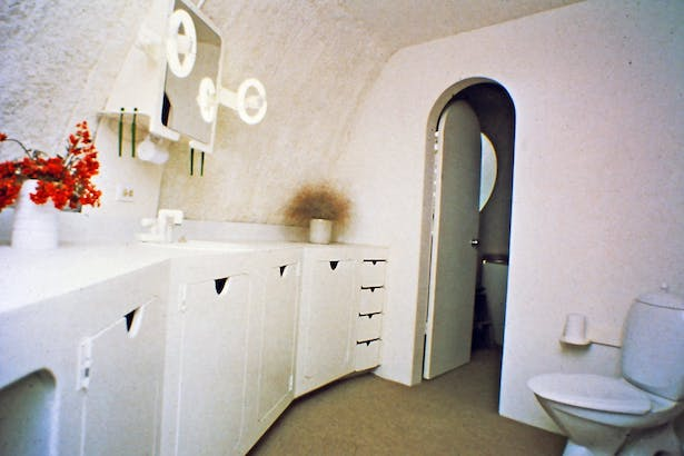 bathroom with low flush toilet.