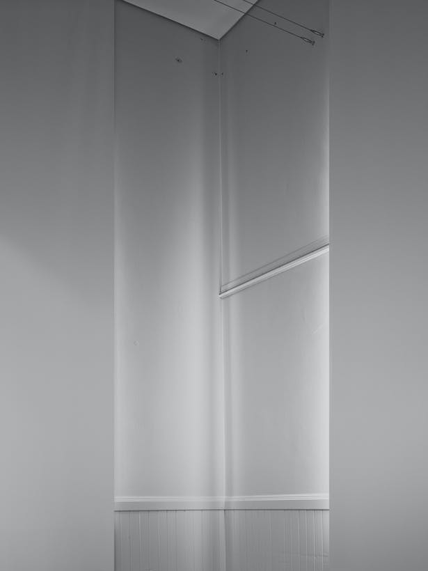 Two blackout shades create a unique corner condition. The reflected light illuminates a corner in a ghostly way.