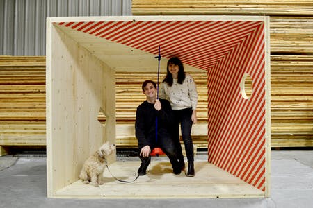 Jessica Colangelo and Charles Sharpless, principals of Somewhere Studio, in the Salvage Swings prototype. Image © Somewhere Studio