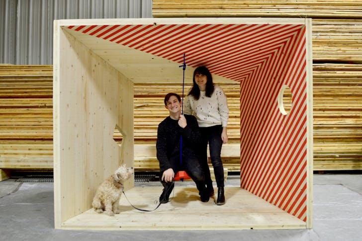 Jessica Colangelo and Charles Sharpless, principals of Somewhere Studio, in the Salvage Swings prototype. Image © Somewhere Studio