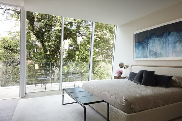 The sleeping area of the master bedroom was partially formed by a sloping glass wall reminiscent of the rooftop artists' studios so prevalent in Greenwich Village.