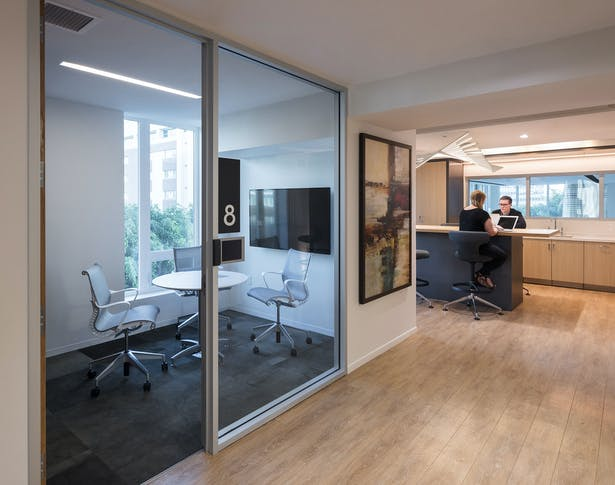 At the building's business center, a combination of private and collaborative rooms are equipped with Wi-Fi, flat screens and a mini kitchen.