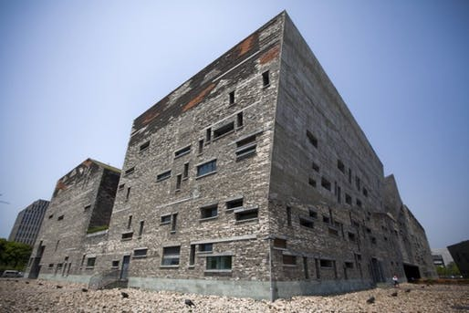 This April 22, 2012 photo shows Ningbo History Museum, one of Chinese architect Wang Shu's most famous works, in Ningbo, in eastern China's Zhejiang province. When Wang accepts his field's richest prize in a ceremony Friday, May 25, 2012, at the seat of China's legislature, a symbolic second winner will be waiting in the background - Hyatt Hotels. (Photo: Associated Press)