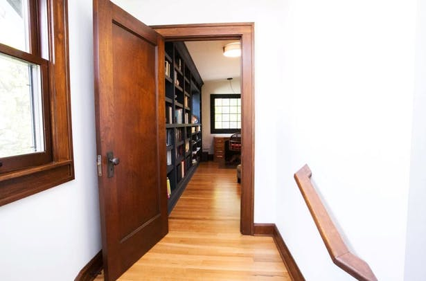 The Home Office is entered from a mid-level landing, providing mental separation from the family spaces (downstairs) and the resting spaces (upstairs).
