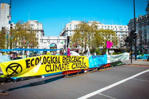 Extinction Rebellion protesters demonstrating for climate action at an April 20th, 2019 rally in London. Image courtesy of Wikimedia user Alexander Savin.