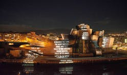 Gehry's Guggenheim Bilbao lights up covered in Jenny Holzer projections this week
