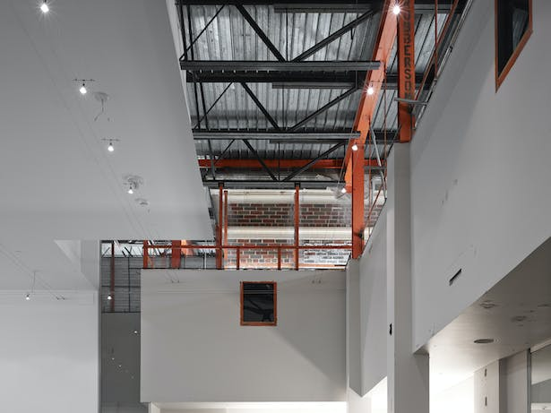 We chose to expose the intersection of the original 1933 building and the 1960s addition. The uplighting of the orange steel and exposed structure celebrates the history and the future.