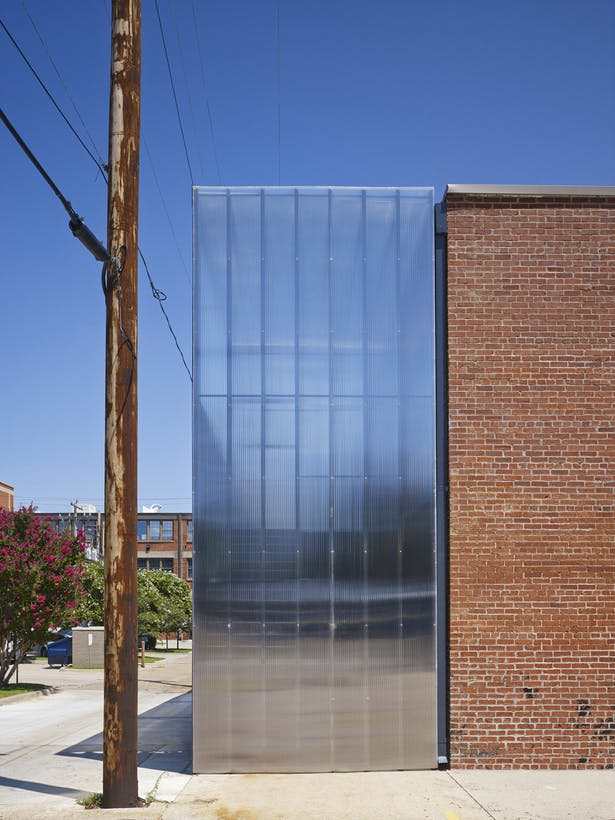 This is the northwest corner showing the polycarbonate addition on the north side. We embraced the alley aesthetic.