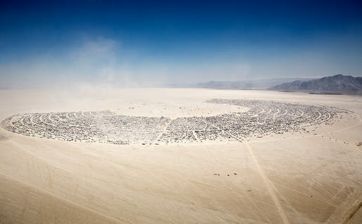 Aerial view of Burning Man gathering at Black Rock City, 2012. Photo by Scott London.