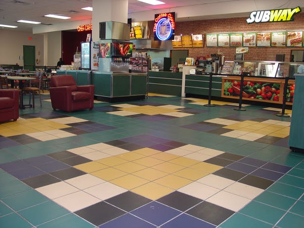 I designed all wall and floor tile layouts and patterns to match Subway's color scheme